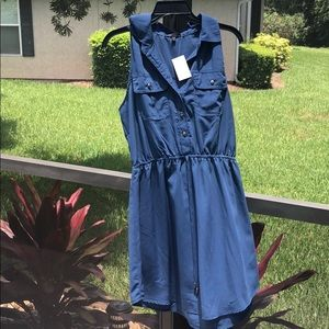 Blue sleeveless shirt dress.